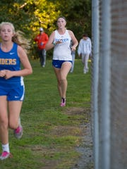 Dover High cross-country runner Emily Cook (right) nears the finish line during an Oct. 18 meet at Schutte Park in Dover.