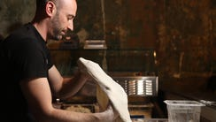Owner and Chef of Razza, Dan Richer, prepares pizza,