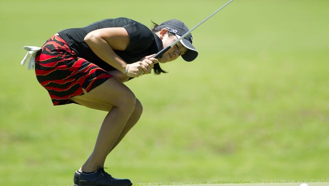Julia Potter watches as a putt falls just short during the Indiana women's open golf tournament at Heartland Crossing Golf Course, Camby, Indiana, Tuesday,  June 28, 2011. Robert Scheer/The Star