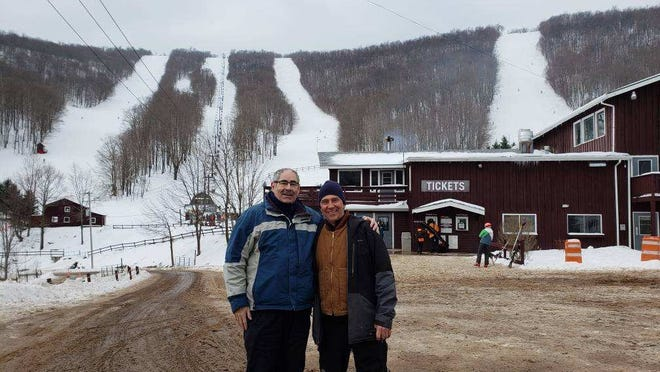 Al Neubert, left, and Plattekill Mountain resort owner Laszlo Vajtay, with the four signature runs in the background: from left to right, Northface, Plunge, Freefall and Blockbuster.