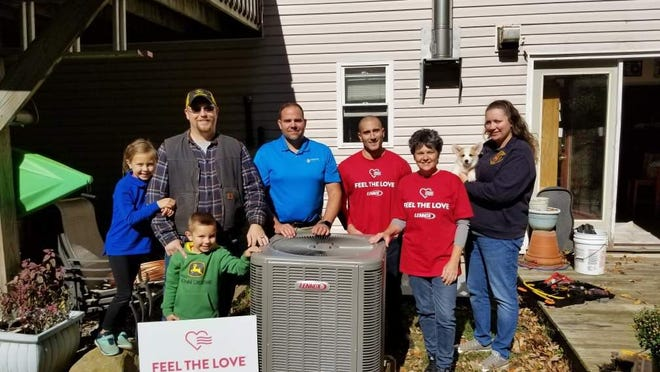 The Korver family of Hampton stands with their new system installed by R. Poust Heating & Cooling employees as winners in October 2019 as winners of last year's Feel the Love campaign. Local residents have until Aug. 31 to nominate members of the community for the 2020 campaign.