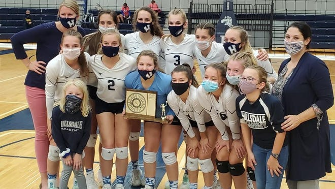 Hillsdale Academy's varsity volleyball team celebrates winning the SCAA East conference title after defeating Pittsford on Thursday. Photo: Lukas Cimbal/Daily News
