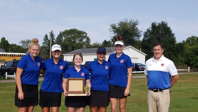 The Lenawee Christian golf team poses for a photo with the IGL championship trophy on Tuesday.