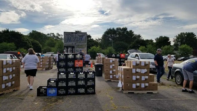 Volunteers are pictured Aug. 1 at a milk giveaway in Jackson organized by Hope and Encouragement for Humanity. Another giveaway will take place From 9 a.m. to 1 p.m. Saturday, Aug. 15, at From 9 a.m. to 1 p.m. Saturday, Aug. 15, the parking lot of St. John's Lutheran Church, 3448 N. Adrian Highway, Adrian.