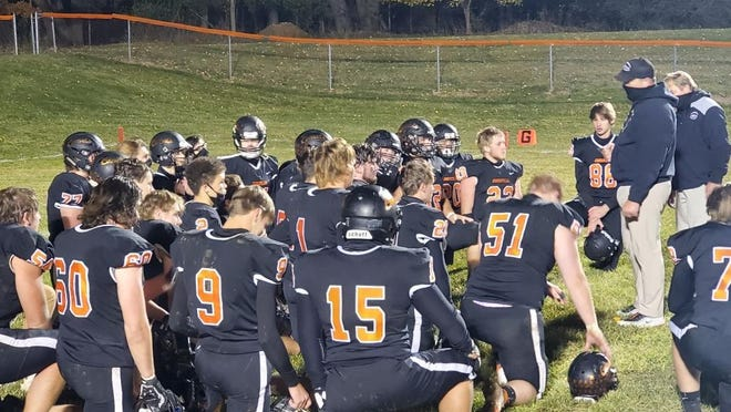 Jonesville coach Frank Keller talks to his football team after the Comets defeated Onsted 48-41 on Friday. Photo: Lukas Cimbal