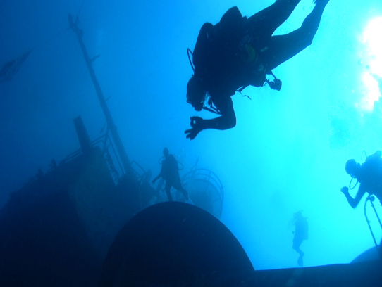 Divers at the Oriskany reef site.