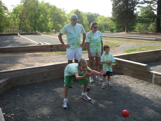 Family members play bocce as part of the County Caper