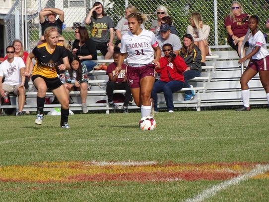 Licking Heights senior Trinity Isom looks for an opening