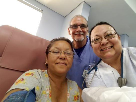 Adelaida Mier takes a photo with the dialysis patient