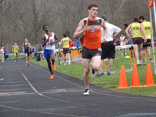 Heath senior Chandler Wilhelm begins the final lap of the 3,200 relay Saturday during the Bulldogs' annual Hank Smith Invitational.