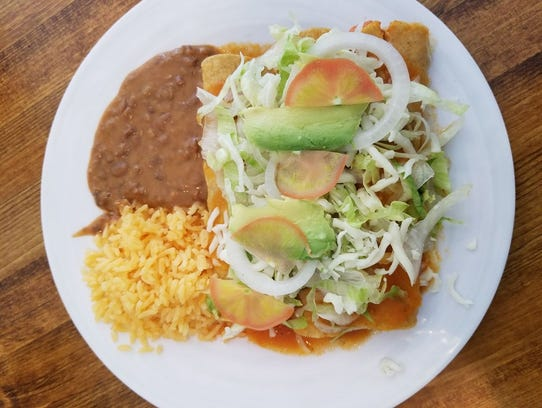 Chicken enchiladas with rice and beans at La Hacienda