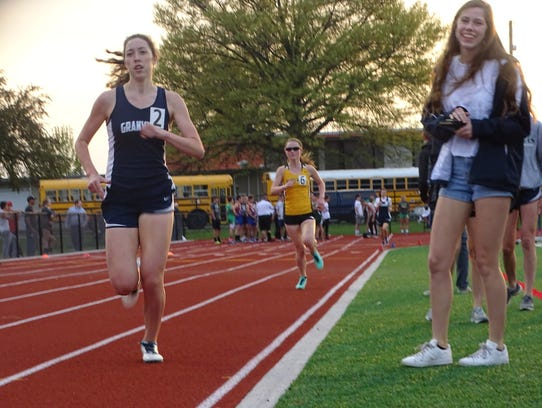 Granville senior Maddie Long leads the 800 this past Friday during the Licking County League-Buckeye Division finals at Lakewood.
