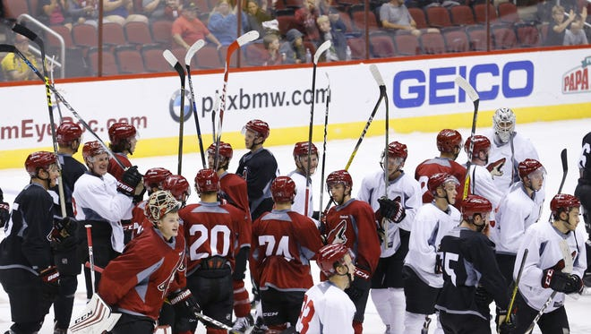 The  Arizona Coyotes celebrate the end of practice during rookie camp Saturday, Sept. 17, 2016 in Glendale.