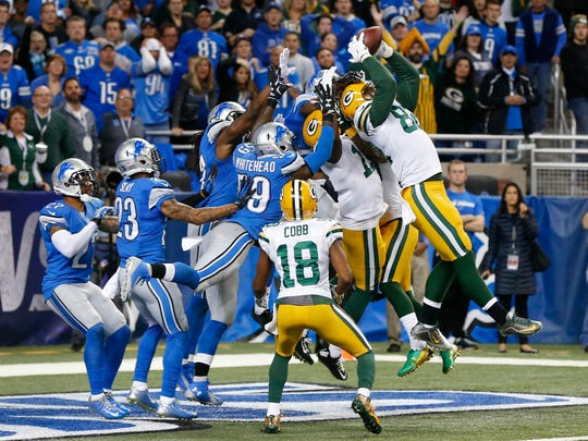 Packers tight end Richard Rodgers, right, catches a 61-yard Hail Mary touchdown pass thrown by Aaron Rodgers with no time remaining to beat the Lions, 27-23, in Detroit on Dec. 3, 2015.