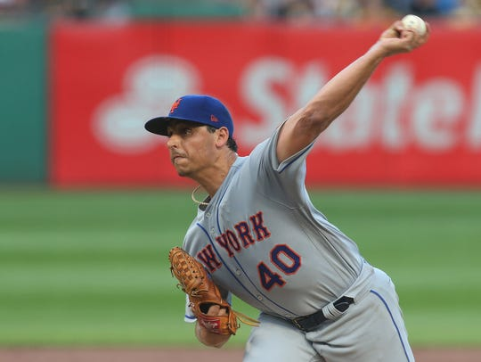 New York Mets starting pitcher Jason Vargas (40) delivers