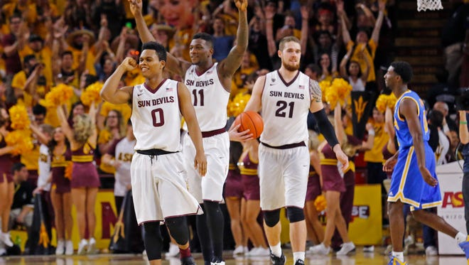Arizona State Sun Devils guard Tra Holder (0) forward Savon Goodman (11) and forward Eric Jacobsen (21) celebrate their 68-66 win over the UCLA Bruins on Feb. 18, 2015 in Tempe.