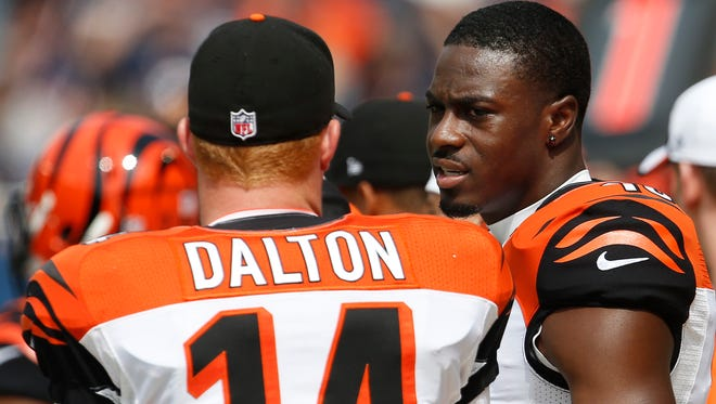 Cincinnati Bengals quarterback Andy Dalton (14) and wide receiver A.J. Green (18) talk during the season opener last year.