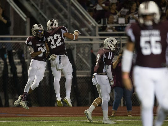 Sinton's Tristan Canales celebrates after making a