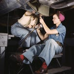 Two women work on building an airplane at the Douglas Aircraft plant in Long Beach, California in 1942.