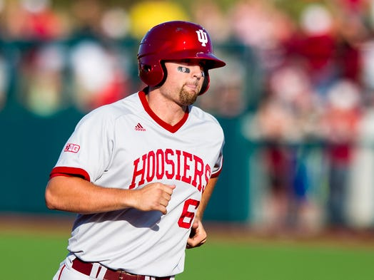 Indiana University's Sam Travis (6) rounds the bases after hitting a home run. Indiana University defeated  Stanford University 4-2 in the semi-final round of the NCAA Regional Baseball tournament, Saturday, May 31, 2014, in Bloomington, Ind.
