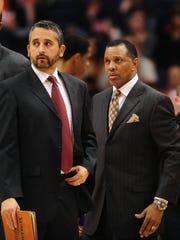 Then assistant Igor Kokoskov and former Suns coach Alvin Gentry are seen during a game against the Nets in 2011.