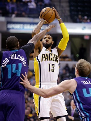 Indiana Pacers forward Paul George (13) puts up a three-pointer over Charlotte Hornets forward Michael Kidd-Gilchrist (14) in the first half of their game  Wednesday, March 15, 2017, evening at Bankers Life Fieldhouse.