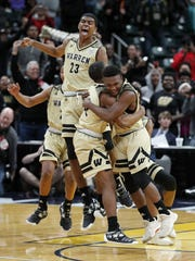 The Warren Central Warriors  celebrate their IHSAA 4A boys basketball state finals win at Bankers Life Fieldhouse on Saturday, March 24, 2018. The Warren Central Warriors  defeated the Carmel Greyhounds  54-48.