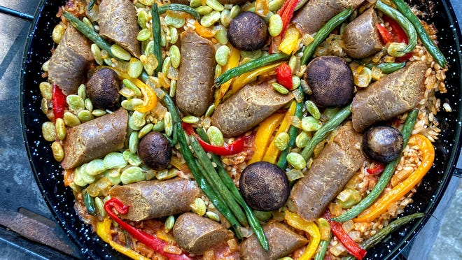You can cook a paella indoors on a stove or outside over a propane or charcoal grill. This plant-based paella has Tofurky sausage, lima beans, mushrooms and a no-fish seafood broth from Ocean's Halo.