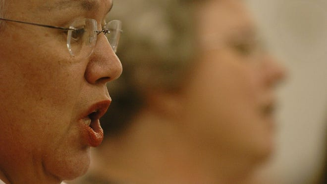 Jean Hammond, left, and Carol Parrilli sing during the Larimer Chorale practice.