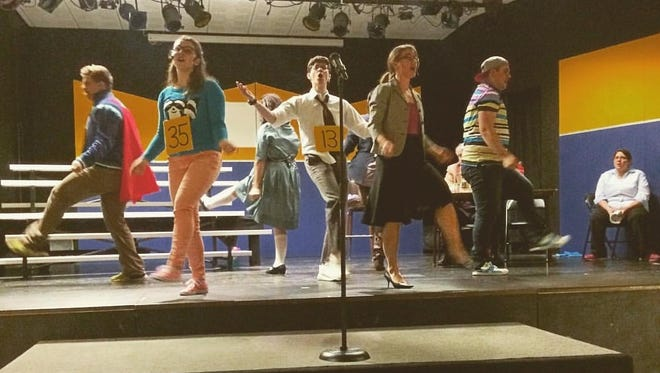 """Actors rehearse a scene from """"The 25th Annual Putnam County Spelling Bee,"""" a musical to be performed by the Pankratz Arts Exchange in Mount Calvary."""