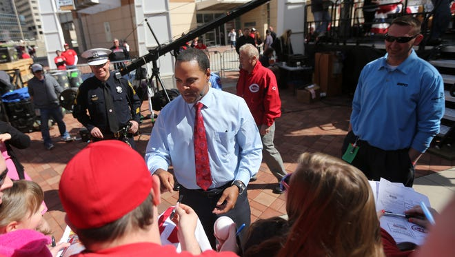 Barry Larkin signs autographs for fans outside Great American Ball Park on Opening Day.