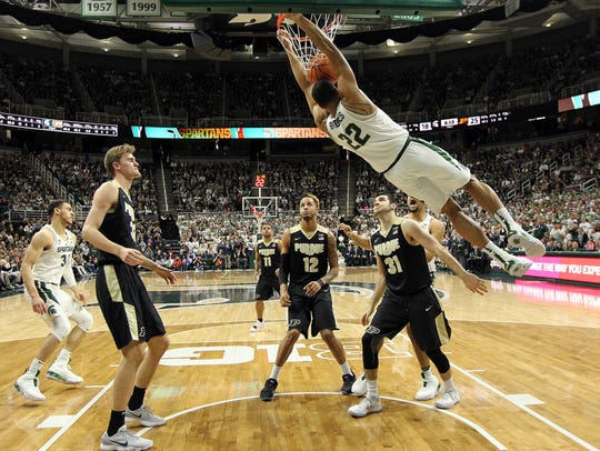 Michigan State Spartans guard Miles Bridges (22) dunks
