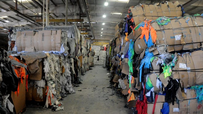 Clothing recycling plant Phoenix Fibers' 100,000-square-foot warehouse in Chandler.