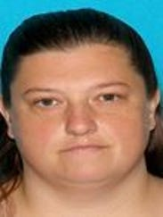 Casino worker wife charged in theft