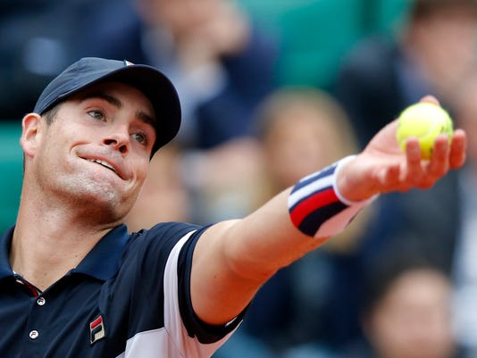 FILE - In this May 29, 2016, file photo, John Isner, of the United States, serves to Britain's Andy Murray at the French Open tennis tournament at Roland Garros stadium in Paris. Six of the world's top 25 male tennis players, including rising star Dominic Thiem of Austria and No. 1 America Isner, are skipping the Rio Olympics. (AP Photo/Michel Euler, File)