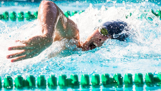 EDGE's Joaquin Pinga takes a breath during his record-breaking Male 14 & Under 200-yard freestyle at the Champlain Valley Swim League championships on Friday July 28 at Saint Albans City Pool.