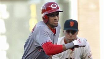 Billy Hamilton is caught in a rundown between second and third base during the first inning.