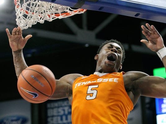 Tennessee's Admiral Schofield dunks for Tennessee's final basket in their 61-59 win over Kentucky during an NCAA college basketball game, Tuesday, Feb. 6, 2018, in Lexington, Ky. (AP Photo/James Crisp)