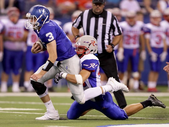 Roncallli's Cade Morgan (right) leads the way on the