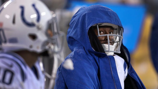 Indianapolis Colts wide receiver T.Y. Hilton (13) sits on the bench under cover during the second half of an NFL football game Monday, Nov. 2, 2015, at Bank of America Stadium in Charlotte, North Carolina.