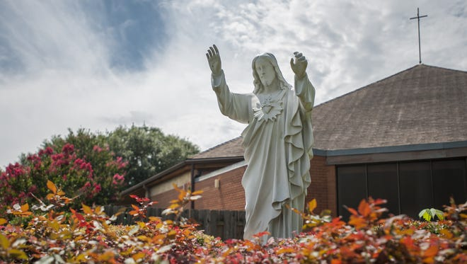 A statue of Jesus Christ is at St. Pius X Catholic Church.