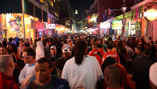 New Orleans' Bourbon Street is shown in this file photo. Senate Bill 492 would allow cities to establish entertainment districts where patrons could carry alcoholic drinks from one establishment to another, much like they can on Bourbon Street.