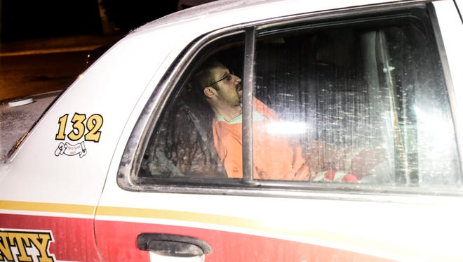 Michael Fiocco sits in a Broome County Sheriff's patrol vehicle after he was arraigned in Maine Town Court on a second-degree murder charge.