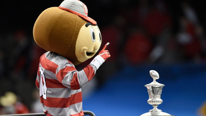 Ohio State Buckeyes mascot Brutus poses with the trophy after the 2015 Sugar Bowl.