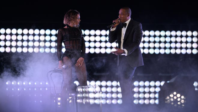 Beyonce and Jay Z perform at the 56th Annual Grammy Awards.