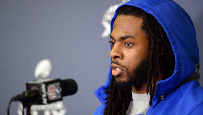 Seattle Seahawks cornerback Richard Sherman fields and answers questions during at press conference at the Arizona Grand Hotel in preparation for Super Bowl XLIX.