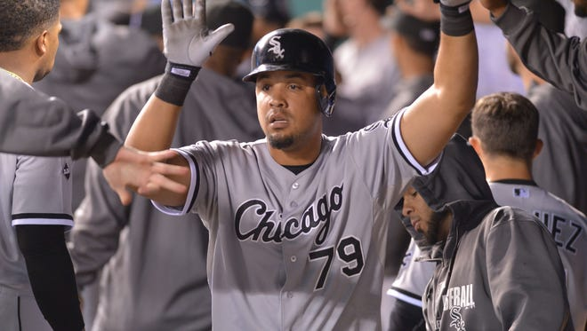 Chicago White Sox first baseman Jose Abreu (79) is congratulated by teammates in the dugout after scoring in the seventh inning against the Kansas City Royals at Kauffman Stadium in Kansas City, Mo., on Sept. 16.