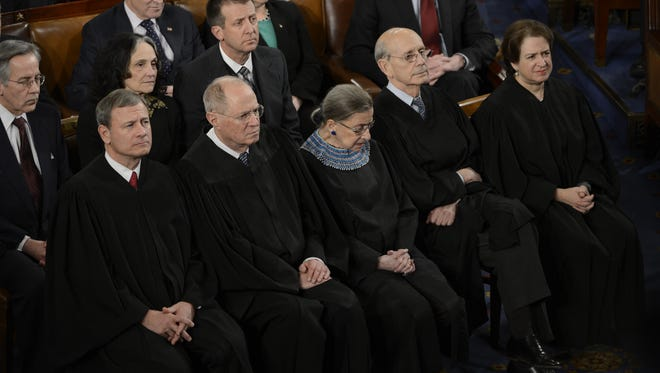 President Obama deliver his State of the Union speech in 2014 while Justice Ruth Bader Ginsburg nods off.