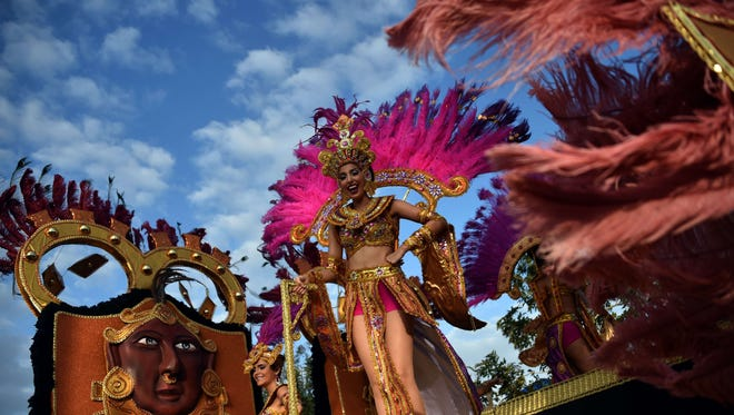 A reveler performs during a Carnival parade in Panama City, Fla., on Feb. 16, 2015.