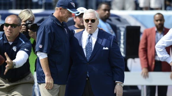 Titans president and CEO Tommy Smith, right, talks